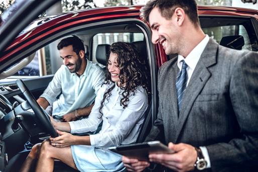 Salesman making a prestigious car deal